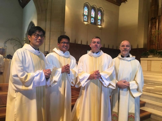 Alan Wong, Nico Lariosa and Rob Morris with Fr Dan Madigan on right.
