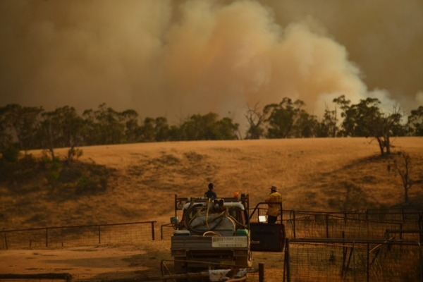 Rural Fire Service firefighters views a flank of a fire on 11 January 2020 in Tumburumba, NSW. (Photo by Sam Mooy/Getty Images)