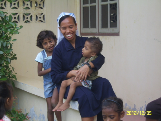 One of the Alma Nuns with some of the children with whom the sisters work.