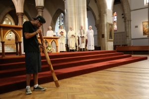 Didgeridoo performance by Brent Watkins during the Mass