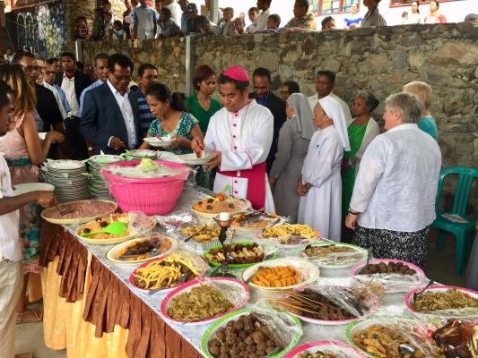 Bishop of Dili, Virgílio do Carmo da Silva SDB joins parishioners at lunch
