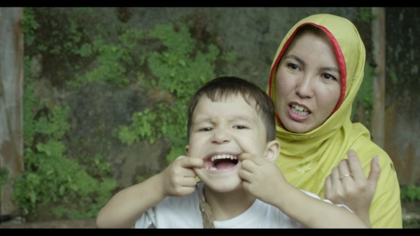 A mother and child who are seeking asylum, as featured in The Staging Post.