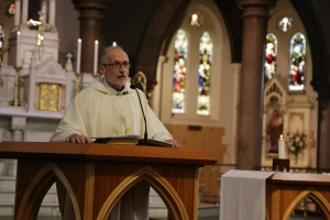 Fr Brian McCoy says Mass for staff at Jesuit Social Services.